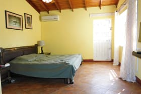 Main Bedroom with access to the pool and back garden