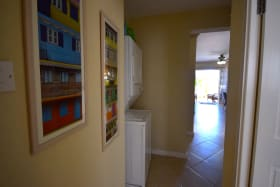 Hallway with stackable washing machine and dryer