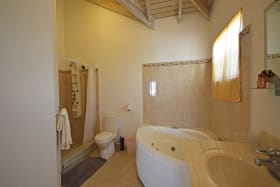 Main bathroom with a tub and shower