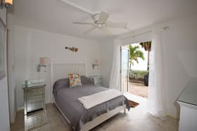 Guest bedroom opening up to the courtyard and beach