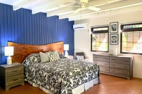 Ground floor bedroom with small fridge, owners lock up and en suite