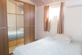 Second Bedroom with double bed and large cupboard. A/C invertor unit.