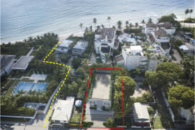 Aerial View of the building in Red, yellow walkway to the beach