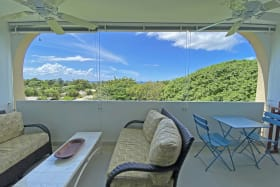 Comfortable terrace with ocean and garden views
