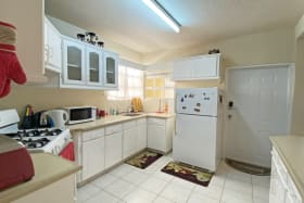 Kitchen with a breakfast bar to the right