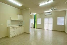 Open plan office and kitchenette on ground floor