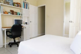 Main bedroom with additional cupboard space and desk area