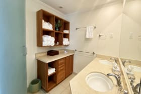 En suite master with double sinks and walk in shower