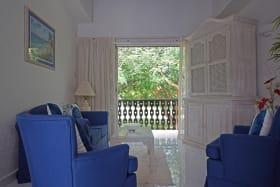 Living room & terrace with garden views