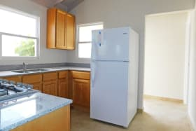 Kitchen with Fridge stove and gas oven. (natural gas)
