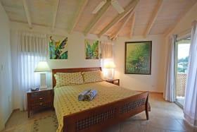Main bedroom with a balcony