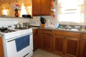 kitchen with wooden cabinets and solid counter tops (appliances not included)