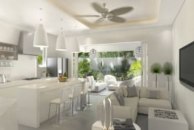 Open plan modern kitchen and living area that flow to the outdoor patio