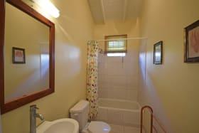 Shared bathroom with a tub