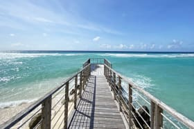 Breathtaking views of the sea on either side of private jetty