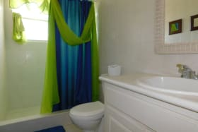 Shared bathroom with a shower and single vaniety