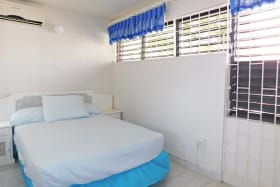 Bedroom 2 with a double bed and AC
