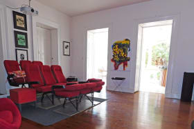 Media room located next to the back patio (STAGED FOR PHOTOS ONLY - FURNITURE NOT INCLUDED)