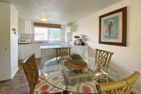 Indoor dining and open plan kitchen
