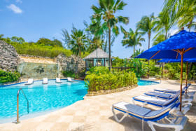 Pictureque shared pool with poolside and in pool loungers