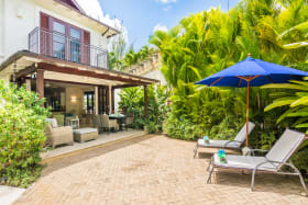 Spacious terrace flows to outdoor seating area in the private garden