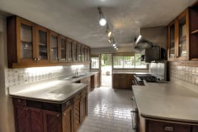 Large Kitchen - Solid Counters & Cabinetry