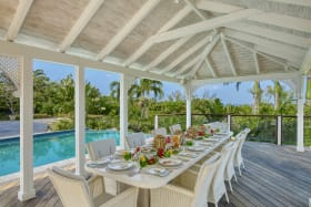Pool gazebo set with a coral table for 12 people to dine elf fresco