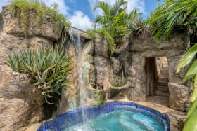 Waterfall to plunge pool and secret cave