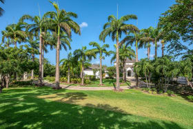 Beautiful meandering entrance drive framed by commanding Royal Palms
