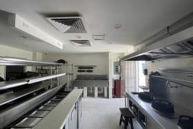 Kitchen area with delivery door