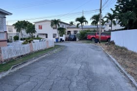 Entry to the lot with middle income home surrounding