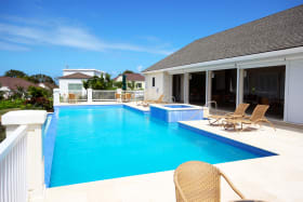 Club house with pool and gorgeous country & ocean views