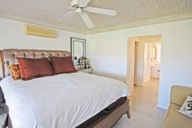 Master bedroom on first floor has private balcony with green views