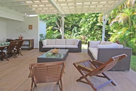 Outdoor patio surrounded by gardens