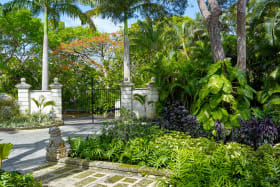 Driveway Entrance to house and lush landscaping