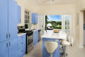 Well equipped kitchen opens to covered verandah and pool