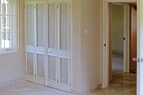Bedroom with built in closets
