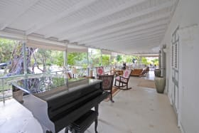 Grand piano on the south verandah