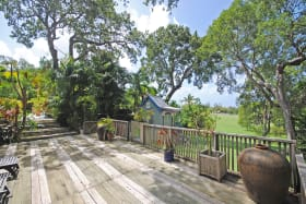 North wooden deck with views of lawn and Holders Polo Field