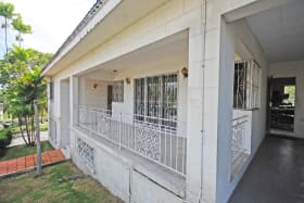 Terrace carport and entrance to kitchen
