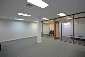 Open plan area with boardroom and two private offices