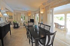 Indoor dining room opens to veranda