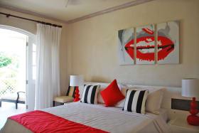 Main bedroom suite with doors to patio