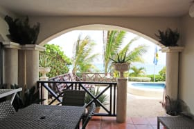 Patio terrace leading to the communal pool with wonderful sea views