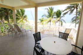 Upstairs patio facing the sea