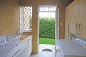 Laundry room opens to enclosed lawn