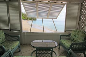 Ground floor seating area with view of Mullins Beach