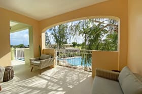 Patio overlooking the pool and Barbados Golf Course