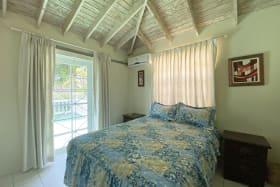 Master Bedroom opening onto the Patio with views of the Barbados Golf Course