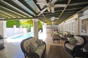 Covered verandah next to swimming pool